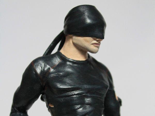 <span>Daredevil Model</span><i>→</i>